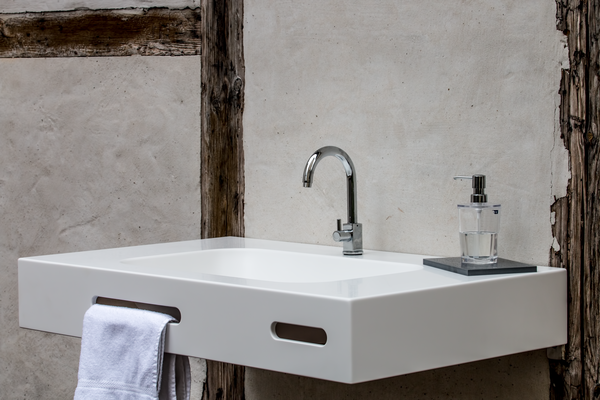 Washbasin lavanto® Lomo with integrated towel holder made of solid surface material