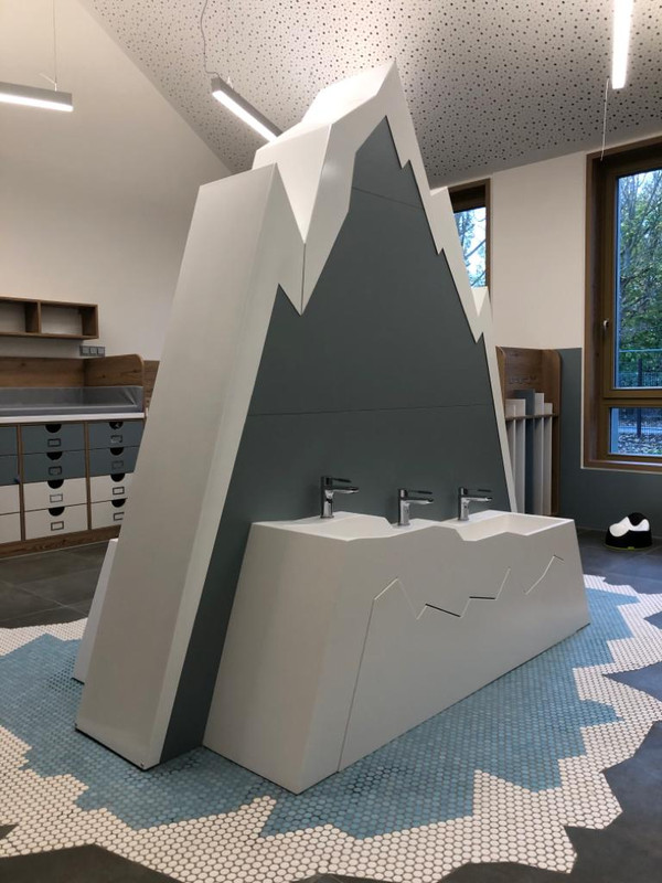 Washbasin made of solid surface material for a nursery