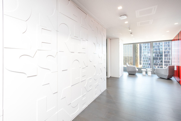 Letter wall cladding made of solid surface material Avonite® - Photo: Tobias Serf Photography